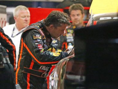 PHOTO: Sprint Cup Series driver Tony Stewart (14) looks over the damage to his car after he hit the wall during a NASCAR Sprint Cup auto race at Atlanta Motor Speedway Sunday, Aug. 31, 2014, in Hampton, Ga.