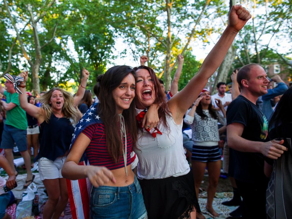 PHOTO: Allison DiFilippo, left, and Samantha Donat, both of New York, react as the United States went up 2-1 over Portugal in the second half as they watched the 2014 World Cup Group G soccer match on Governors Island in New York, June 22, 2014.