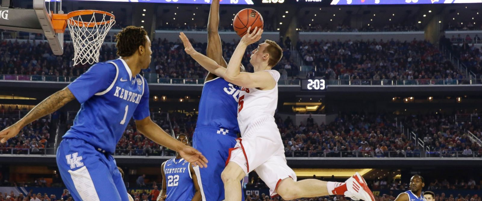 PHOTO: Wisconsin forward Sam Dekker (15) shoots against Kentucky forward Julius Randle (30) during the first half of the NCAA Final Four tournament college basketball semifinal game Saturday, April 5, 2014, in Arlington, Texas.