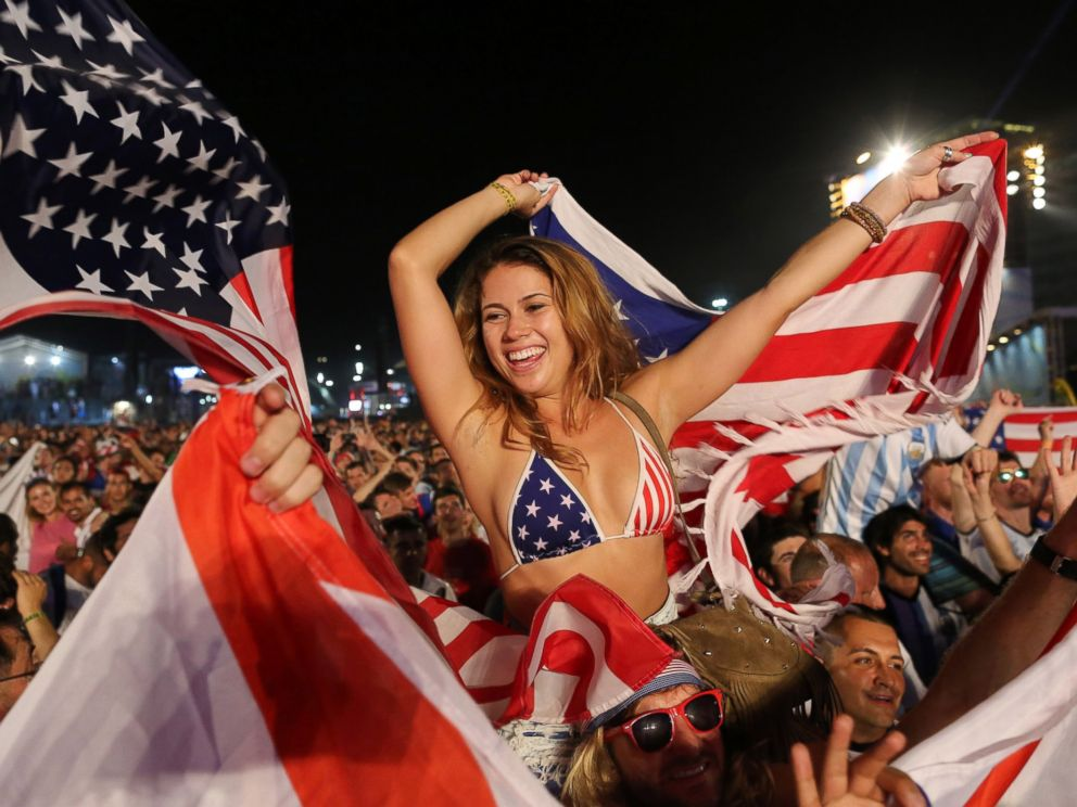 PHOTO: Fans of the U.S. national soccer team celebrate their victory over Ghana inside the FIFA Fan Fest area on Copacabana beach, Rio de Janeiro, Brazil, June 16, 2014.