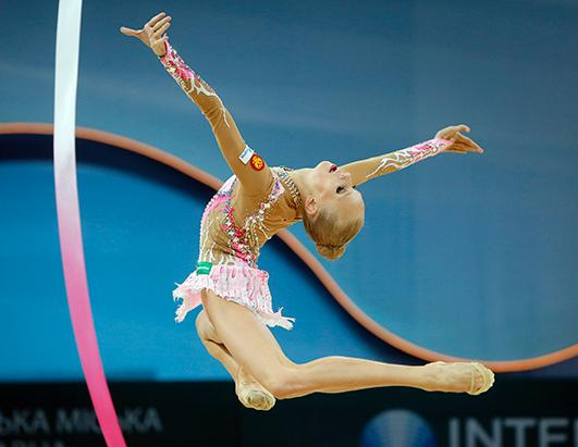 a look at the flexible sport of rhythmic gymnastics In rhythmic gymnastics, the athletes use equipment such as hoops, balls, ropes,  clubs  top rhythmic gymnasts must have many qualities: balance, flexibility,  coordination and  when watching a routine, be sure to look for.