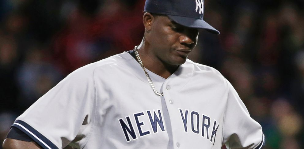 PHOTO: New York Yankees starting pitcher Michael Pineda walks off the mound after being ejected from a game against the Boston Red Sox when a foreign substance was discovered on his neck, Fenway Park in Boston, April 23, 2014.