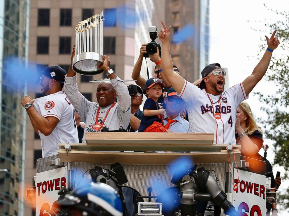 PHOTO: Houston Mayor Sylveter Turner, left,holds up the World Series trophy as the Houston Astros World Series MVP George Springer (4) cheers during parade honoring the World Series baseball champions, Nov. 3, 2017, in Houston.