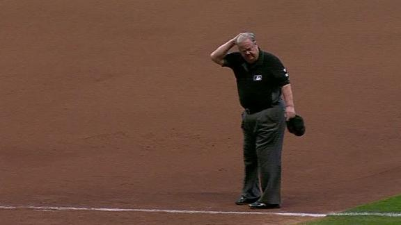 Umpire hit in head by ball from stands