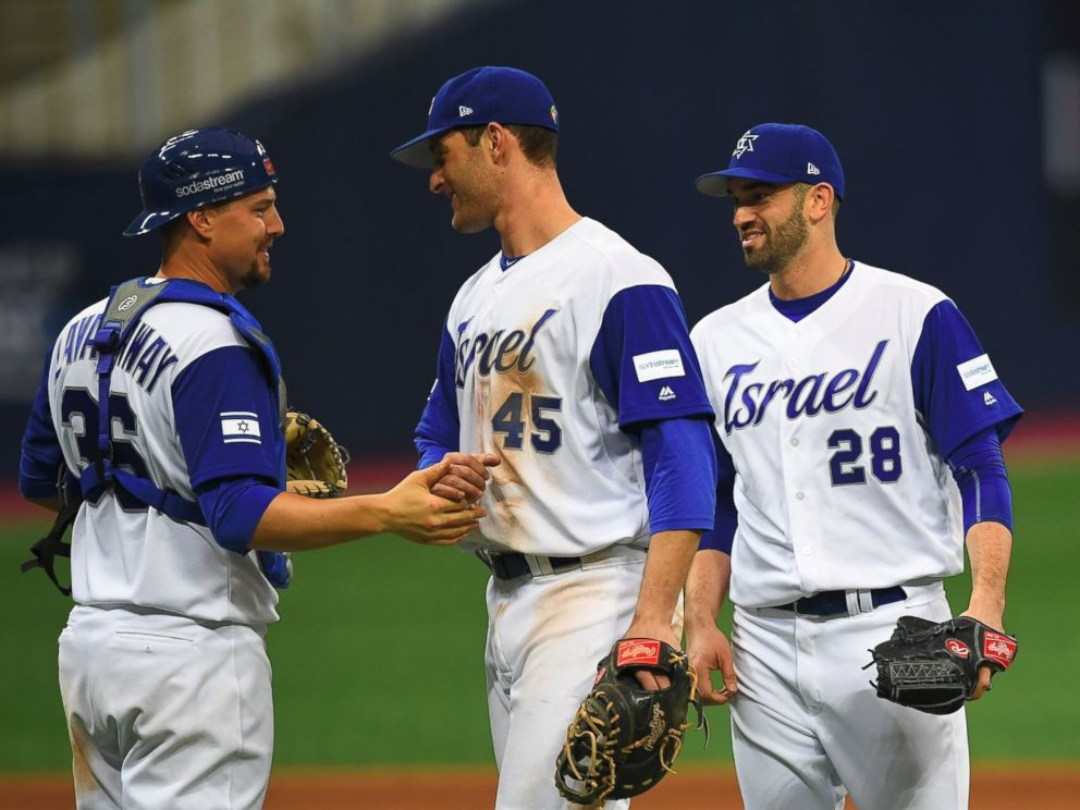 PHOTO: Catcher Ryan Lavarnway of Israel celebrates a victory over the Netherlands with infielder Nate Freiman and pitcher Josh Zeid after their first round game of the World Baseball Classic at Gocheok Sky Dome in Seoul on March 9, 2017.