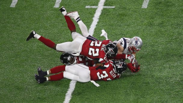 PHOTO: Julian Edelman of the New England Patriots makes a 23 yard catch in the fourth quarter against Ricardo Allen, Robert Alford and Keanu Neal of the Atlanta Falcons during Super Bowl 51 at NRG Stadium on Feb. 5, 2017 in Houston.