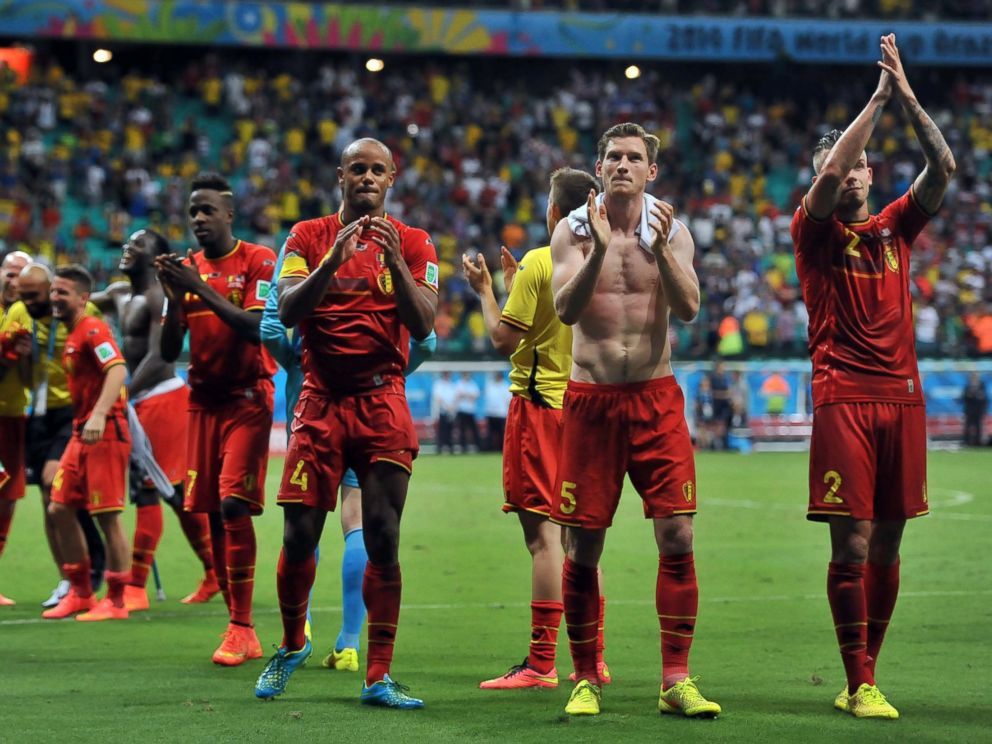 PHOTO: Belgian players celebrate their victory after the World Cup match between Belgium and the USA at the Arena Fonte Nova in Salvador, Brazil on July 1, 2014.