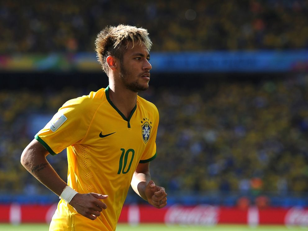 PHOTO: Neymar of Brazil looks on during the 2014 FIFA World Cup Brazil match between Brazil and Chile at Estadio Mineirao on June 28, 2014 in Belo Horizonte, Brazil.