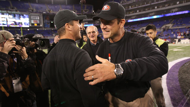 PHOTO: Head Coach Jim Harbaugh of the San Francisco 49ers embraces his brother Head Coach John Harbaugh of the Baltimore Ravens prior to the game at M&T Bank Stadium, Nov. 24, 2011, in Baltimore.