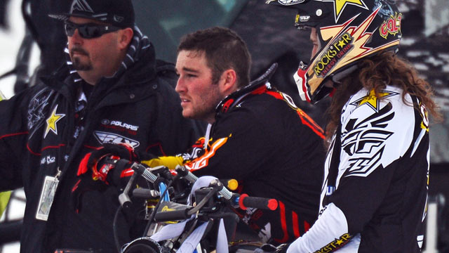 PHOTO: Caleb Moore, center, watches practice for Snowmobile Freestyle, Jan. 24, 2013, during the 2013 Winte