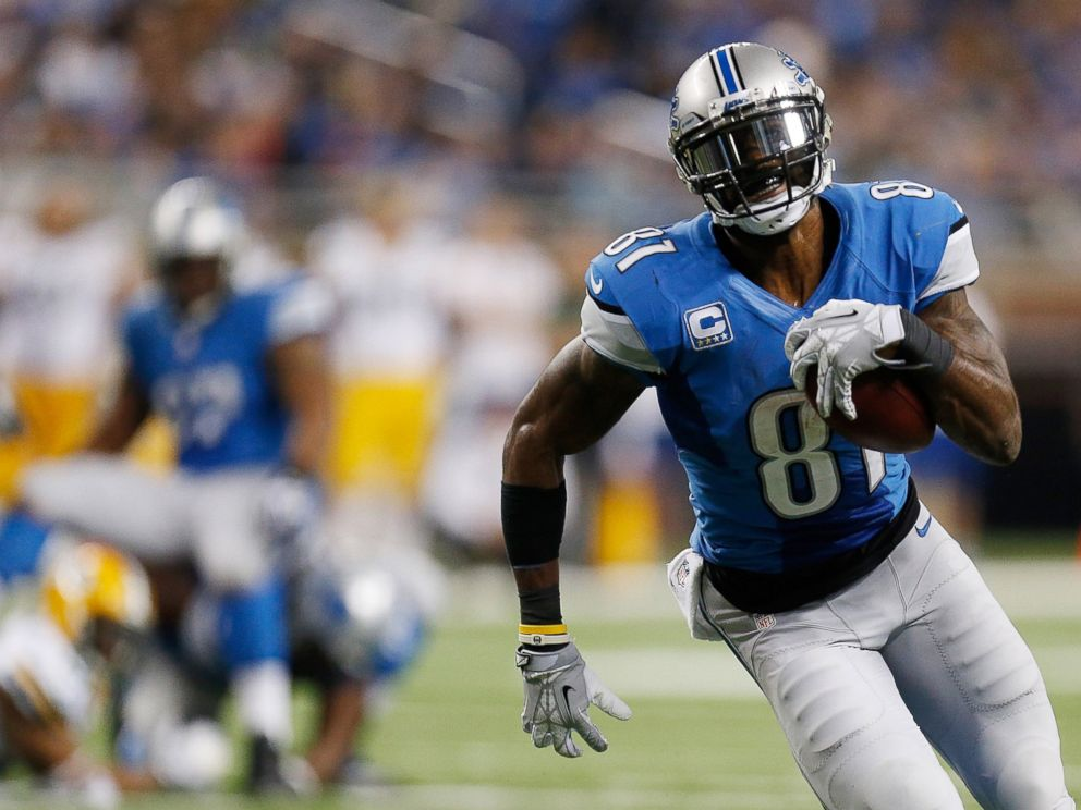 PHOTO: Calvin Johnson of the Detroit Lions runs for a third quarter touchdown at Ford Field on Nov. 28, 2013 in Detroit, Michigan.