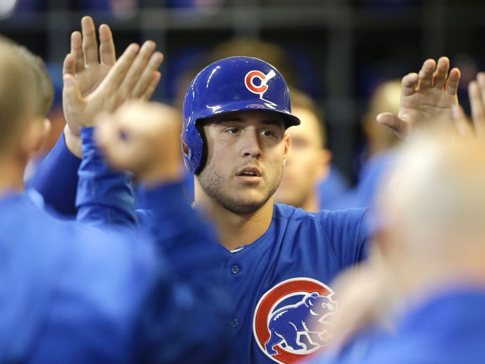PHOTO: Anthony Rizzo #44 of the Chicago Cubs celebrates in the dugout after reaching on a double hit by Starlin Castro in the seventh inning against the Milwaukee Brewers at Miller Park on October 02, 2015 in Milwaukee, Wisconsin.