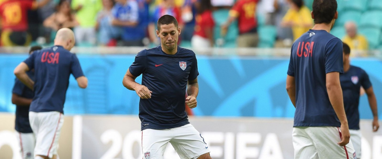PHOTO: US forward Clint Dempsey (C) warms up with teammates ahead of the Round of 16 football match between Belgium and USA at The Fonte Nova Arena in Salvador on July 1, 2014, during the 2014 FIFA World Cup.