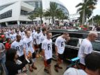 PHOTO: Miami Marlins players and members of the Marlins organization walk next to the hearse carrying Miami Marlins pitcher Jose Fernandez as they  pay their respects in front of the Marlins baseball stadium, Sept. 28, 2016, in Miami, Florida.