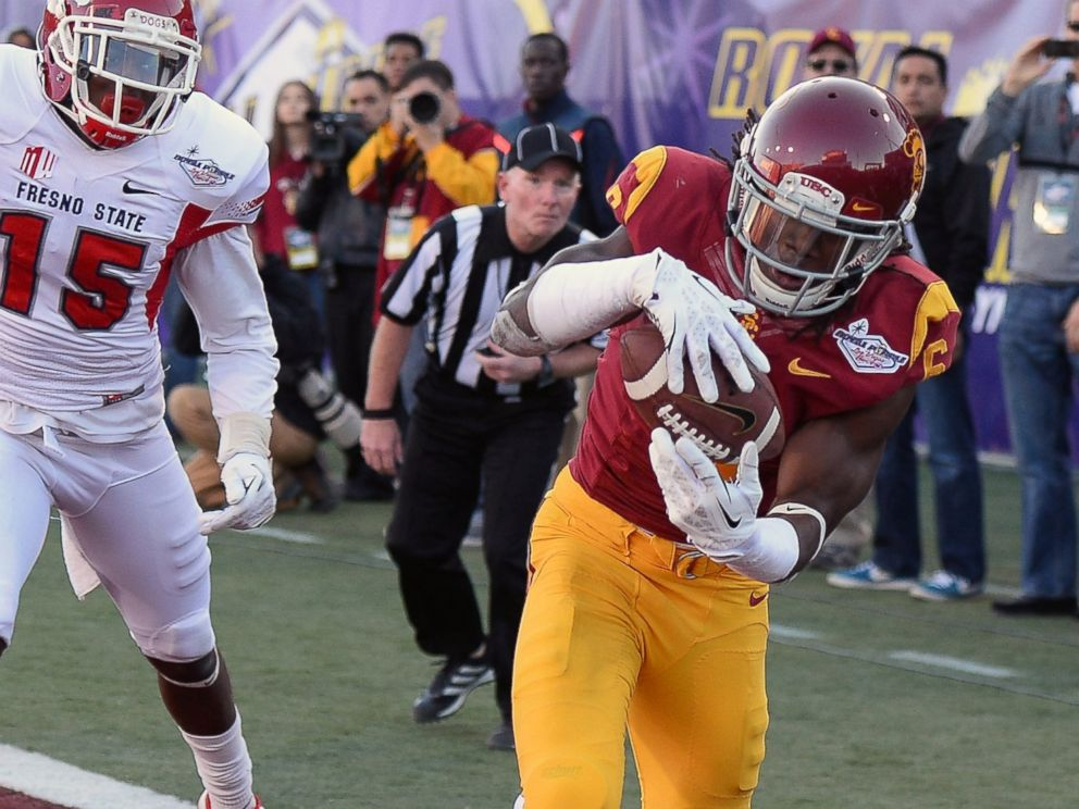 PHOTO: Josh Shaw of the USC Trojans intercepts a pass in the end zone that was intended for Davante Adams of the Fresno State Bulldogs during the Royal Purple Las Vegas Bowl on Dec. 21, 2013 in Las Vegas, Nevada.