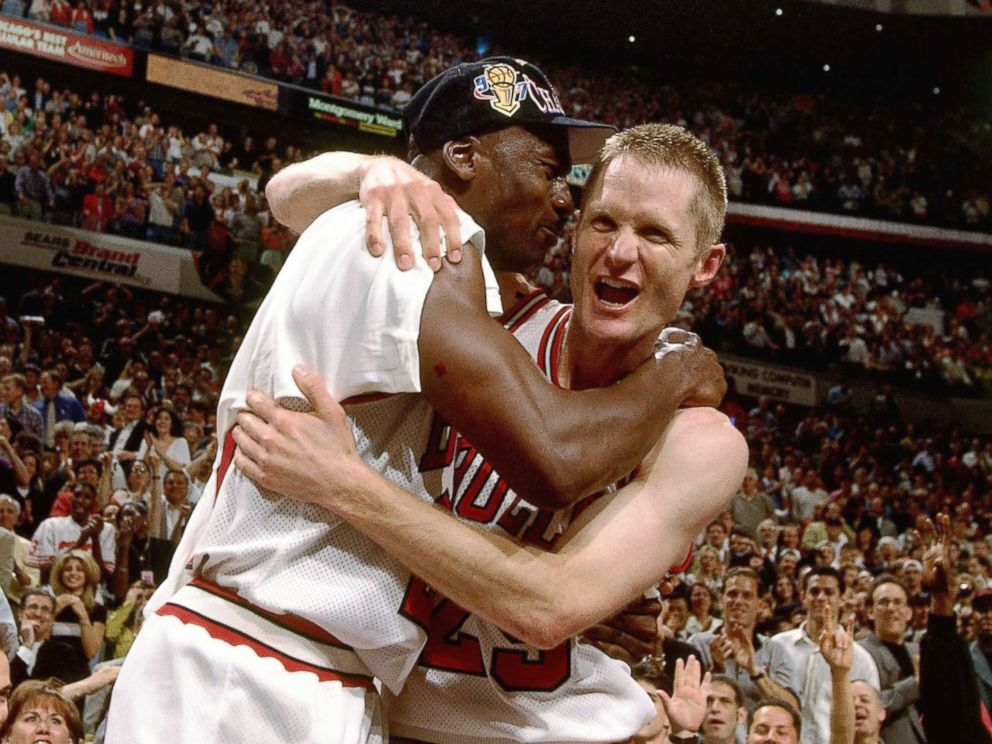 PHOTO: Steve Kerr and Michael Jordan of the Chicago Bulls celebrate after defeating the Utah Jazz to win the NBA Championship at the United Center in Chicago, 1997.