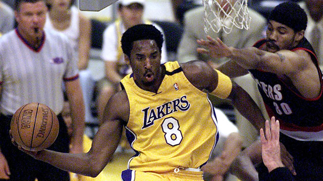 PHOTO: Kobe Bryant, of the Los Angeles Lakers passes the ball during one of the NBA Western Conference finals in Los Angeles, May 20, 2000.