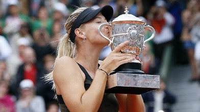 PHOTO: Maria Sharapova holds her trophy after winning the Women's Singles final at the French Open held at the Roland Garros stadium, Paris, FR., June 9, 2012.