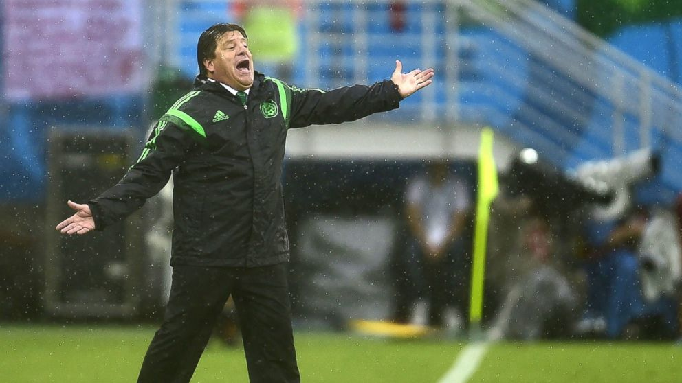 PHOTO: Mexicos coach Miguel Herrera gestures during the soccer match between Mexico and Cameroon in Natal during the 2014 FIFA World Cup on June 13, 2014.