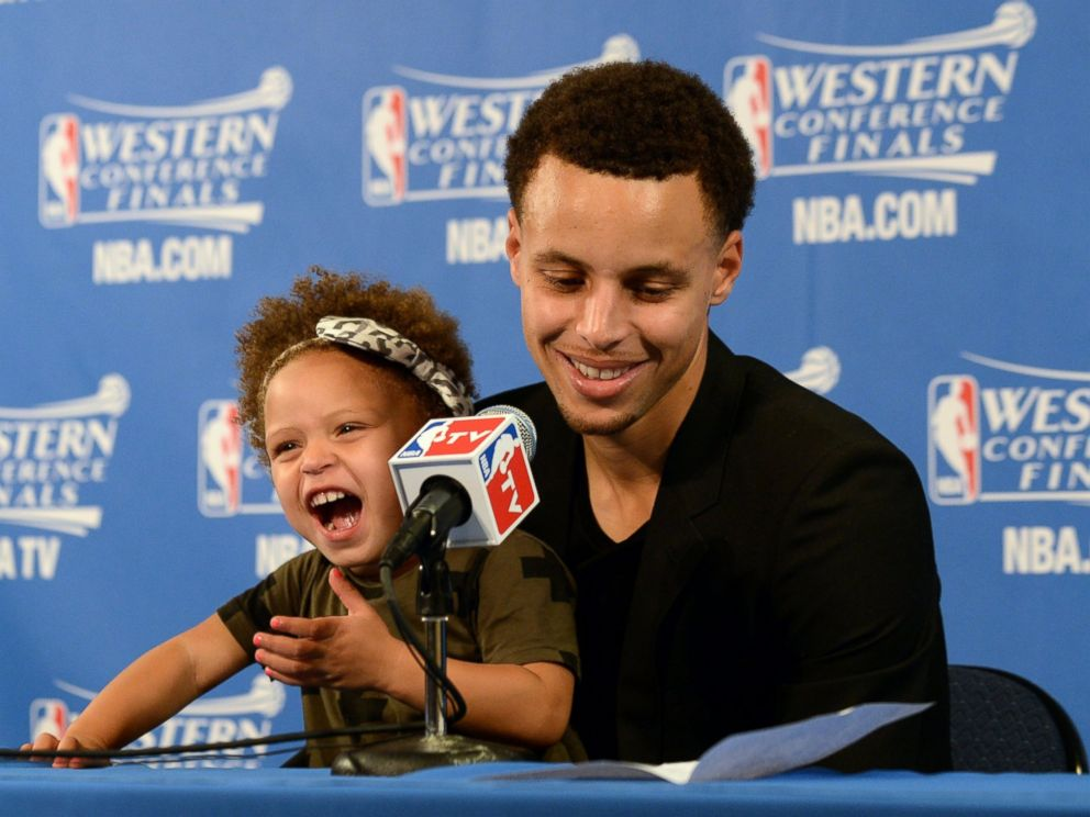 PHOTO: Stephen Curry of the Golden State Warriors and his daughter Riley speak at a press conference after Game One of the Western Conference Finals during the NBA Playoffs at Oracle Arena in Oakland, Calif., May 19, 2015.