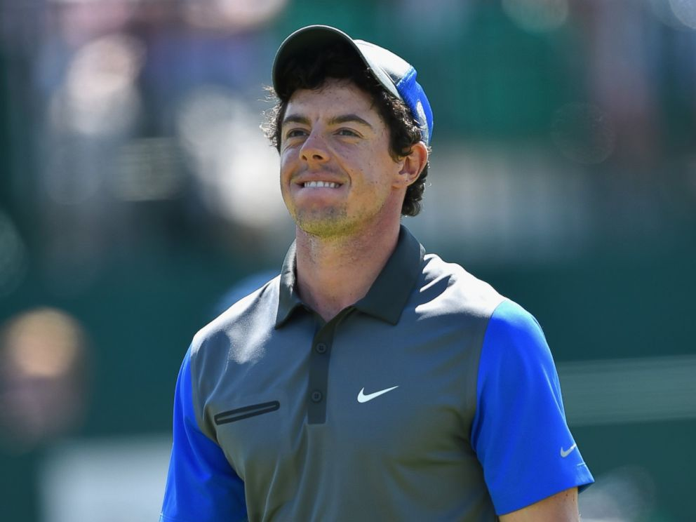 PHOTO: Rory McIlroy of Northern Ireland walks off the 18th green during the first round of The 143rd Open Championship at Royal Liverpool on July 17, 2014 in Hoylake, England.
