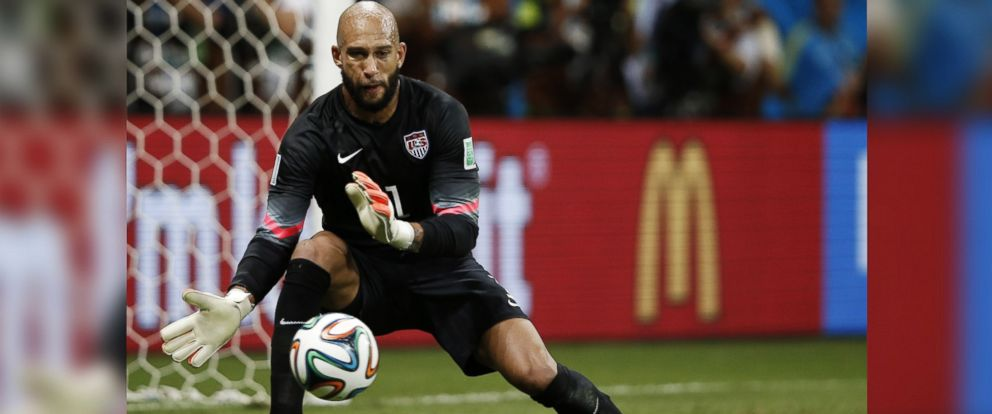 PHOTO: Tim Howard makes a save during extra-time in the World Cup soccer match between Belgium and the USA in Salvador on July 1, 2014.