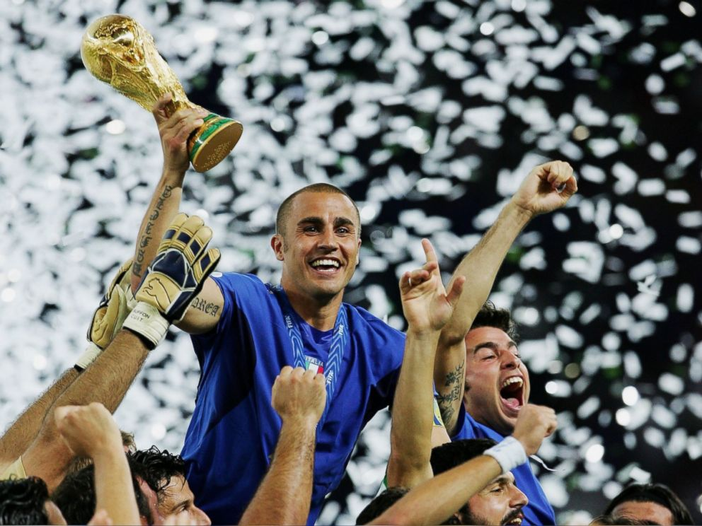 PHOTO: Fabio Cannavaro of Italy lifts the World Cup trophy aloft following victory in a penalty shootout at the end of World Cup Final match between Italy and France at the Olympic Stadium on July 9, 2006 in Berlin, Germany.