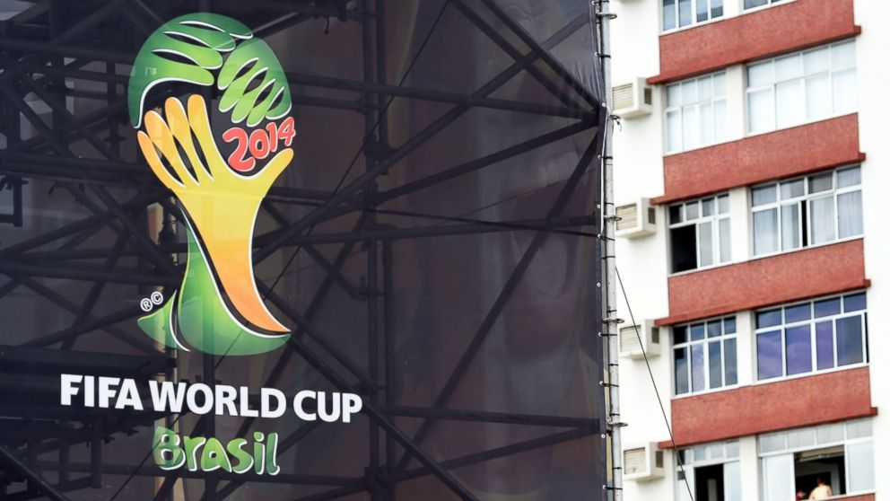 PHOTO: The official World Cup logo is seen on scaffold netting in Salvador on June 14, 2014, during the 2014 FIFA World Cup football tournament.