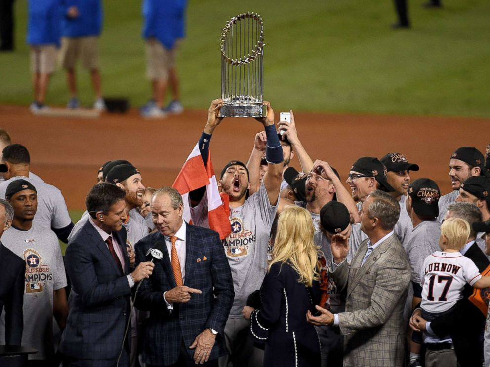 PHOTO: Carlos Correa, #1 of the Houston Astros, hoists the Commissioners Trophy after defeating the Los Angeles Dodgers 5-1 in game seven to win the 2017 World Series at Dodger Stadium on Nov. 1, 2017, in Los Angeles.