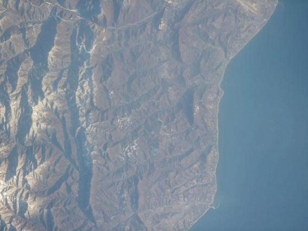 PHOTO: A satellite image taken from the International Space Station on Feb. 10, 2014, shows Sochi, Russia, and the mountains above it.