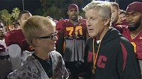 Jake Olson with USC Coach Pete Carroll and members of the football team.