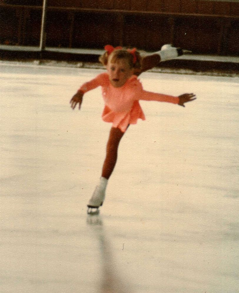 Tonya Harding is seen here skating a young girl in this undated family