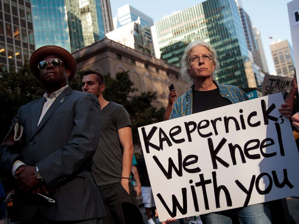 PHOTO: Activists rally in support of NFL quarterback Colin Kaepernick outside the offices of the National Football League on Park Avenue, Aug. 23, 2017, in New York.