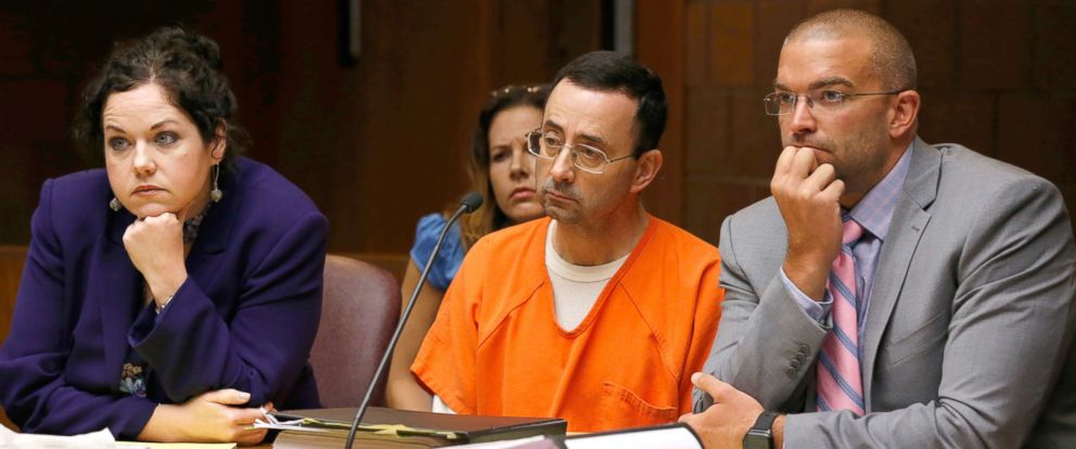PHOTO: Former Michigan State University and USA Gymnastics doctor Larry Nassar (C) with defense attorneys Shannon Smith and Matt Newberg in the 55th District Court where Judge Donald Allen Jr. bound him over, June 23, 2017 in Mason, Mich.