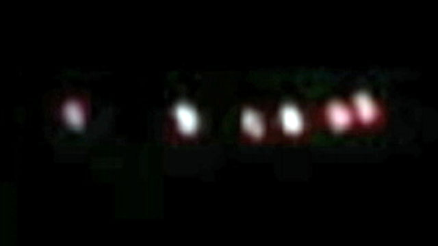 VIDEO: Witnesses dismiss talk that colorful lights are a result of military aircraft exercises.