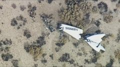 VIDEO: NTSB investigators say the crash in the Mojave Desert was caused by premature moving of the spacecrafts tail wings. Pilot Peter Siebold was injured and co-pilot Michael Alsbury was killed in the October 2014 crash.