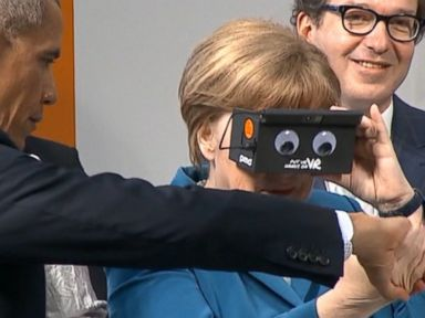 Watch:  Obama and Angela Merkel Geek Out With VR Goggles