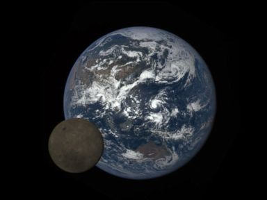 Watch:  When the Moon Photobombs Planet Earth