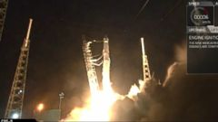 VIDEO: SpaceX successfully launched a critical space station docking port for astronauts early Monday, along with a DNA decoder for high-flying genetic research.