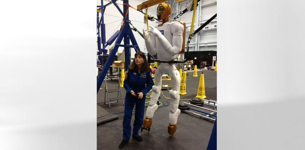 PHOTO: NASA astronaut Cady Coleman with Robonaut.