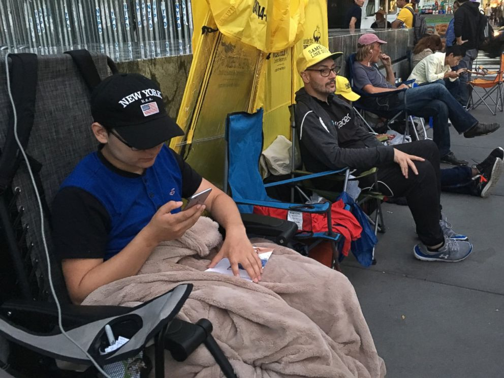 PHOTO: Efstathios Leontaris, a high school senior from Union City, New Jersey, passes time on his iPhone outside Apples 5th Avenue Retail store in New York. Leontaris has been in line for about one week, he said, waiting for the new iPhone 7.