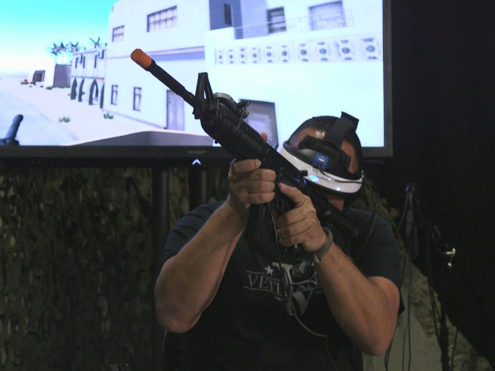 PHOTO: Chris Merkle holds a fake gun while undergoing a virtual reality therapy session that is allowing him to face aspects of his trauma.