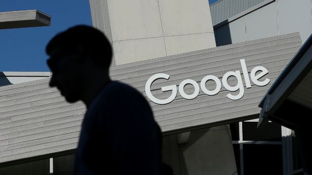 A man walks past a building on the Google campus in Mountain View, Calif.