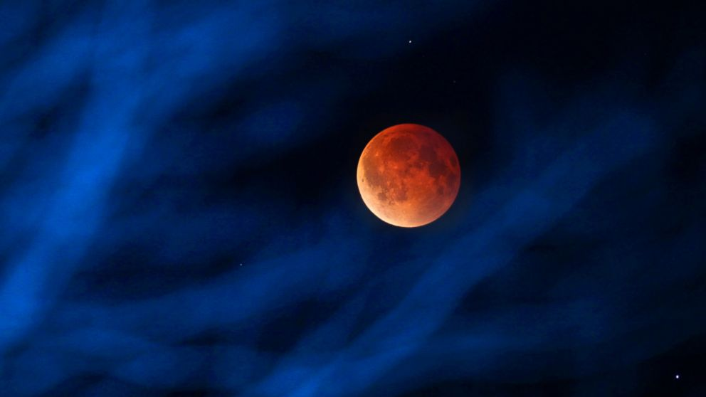 PHOTO: The moon glows a red hue during a total lunar eclipse, April 15, 2014 in Milwaukee.