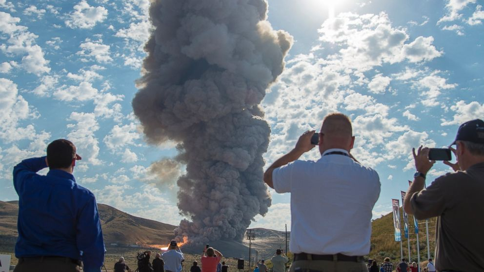 PHOTO: Spectators watch the second and final qualification motor (QM-2) test for the Space Launch Systems booster, June 28, 2016, at Orbital ATK Propulsion Systems test facilities in Promontory, Utah.