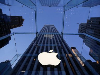 PHOTO: An Apple logo hangs in the glass box entrance to the companys Fifth Avenue store in New York