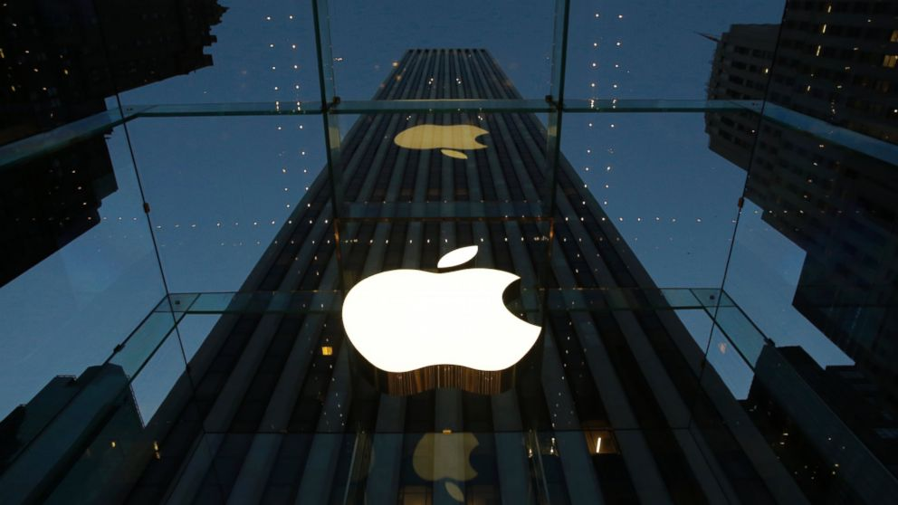 PHOTO: The Apple logo is illuminated in the entrance to the Fifth Avenue Apple store, in New York, Nov. 20, 2013.