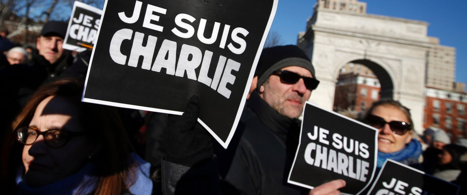 "PHOTO: Attendees hold ""Je Suis Charlie"" signs"