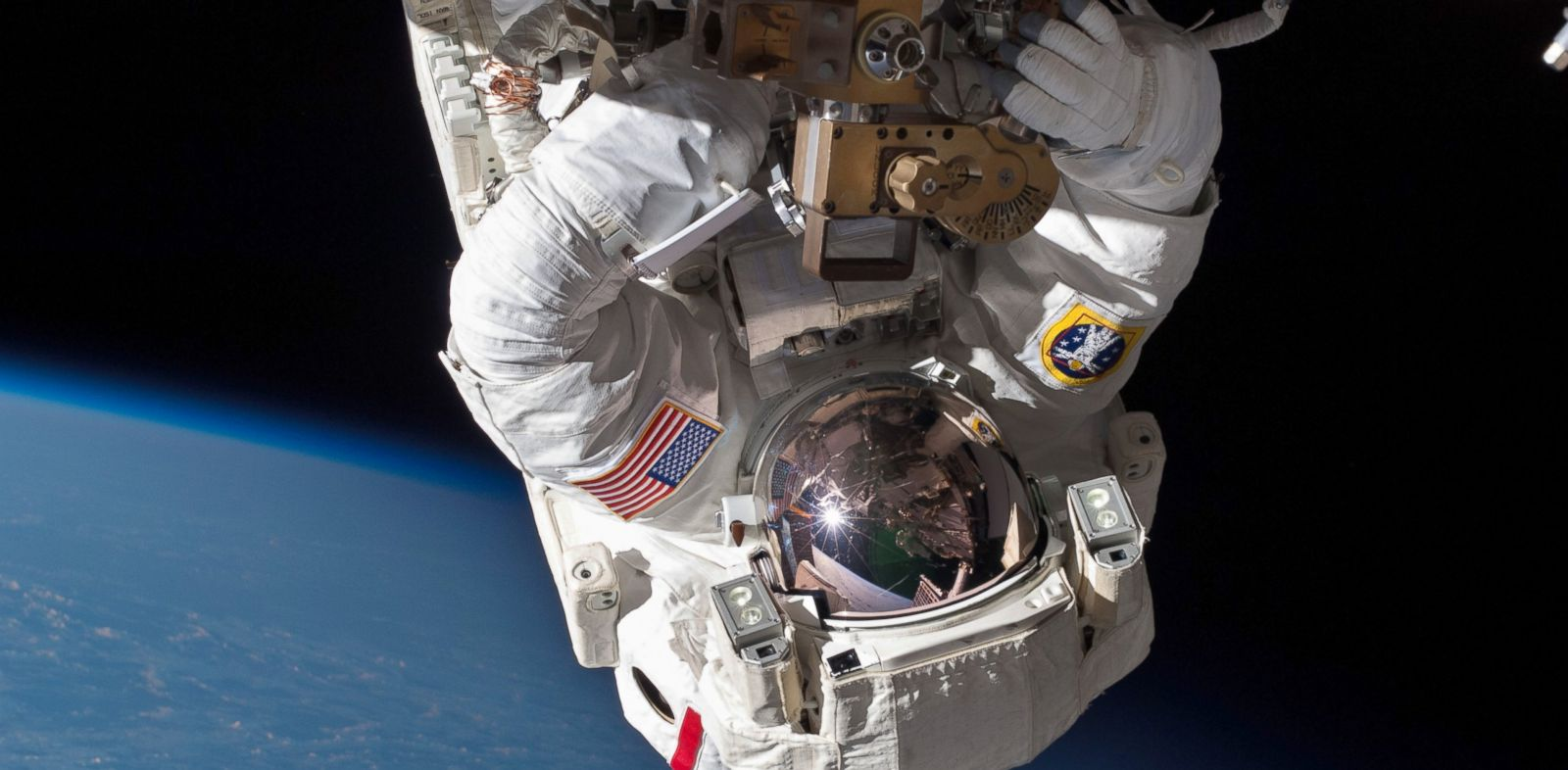 PHOTO: Chris Cassidy performs a space walk to inspect and replace a pump controller box on the ISS