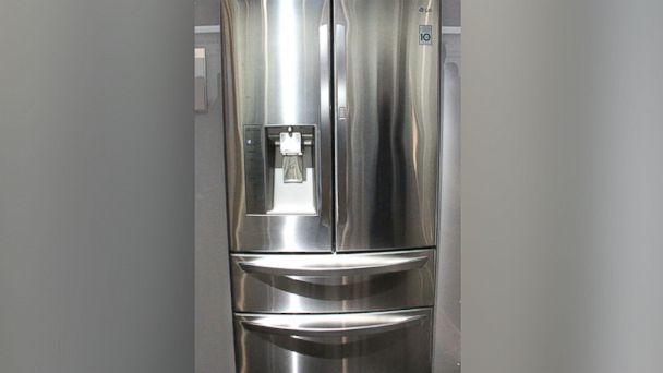 PHOTO: LG shows off its new 4-door with door in door refrigerator at the 2014 International CES show in Las Vegas, USA, 7 January 2014.